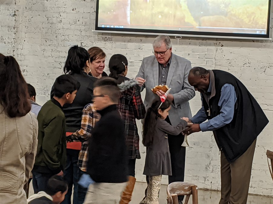 Bishop James Swanson, Sr. serves Communion at Dinner Church, Jan. 26 at Camp 106 in New Albany, MS. Photo courtesy of Jane Horstman.